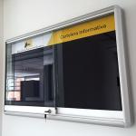 cartelera con vidrios corredizos tamaño 100x80