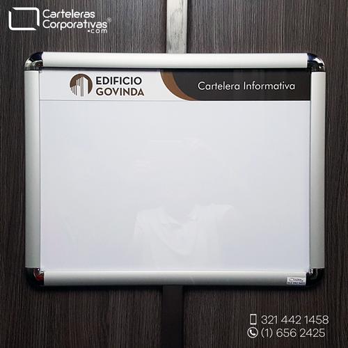 cartelera marco abatible doble carta personalizada vista frontal edificio govinda