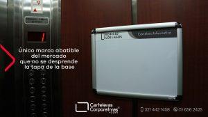 cartelera marco abatible doble carta para ascensor de edificio los lagos unico perfil del mercado que no se cae la tapa